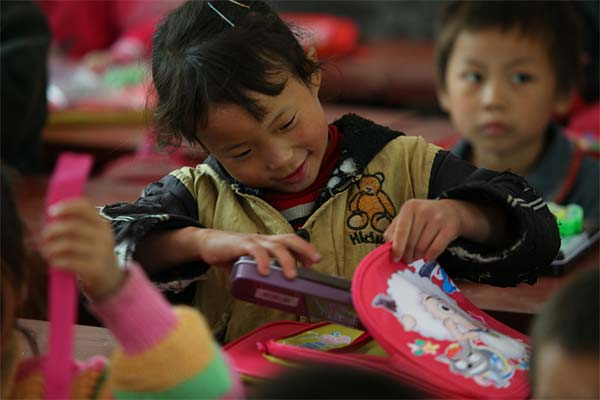 Kids with new school supplies from Nathan Yip Foundation